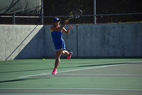 Senior Emilie Scanlon returns a volley in a prior tournament. Scanlon is the teams captain.