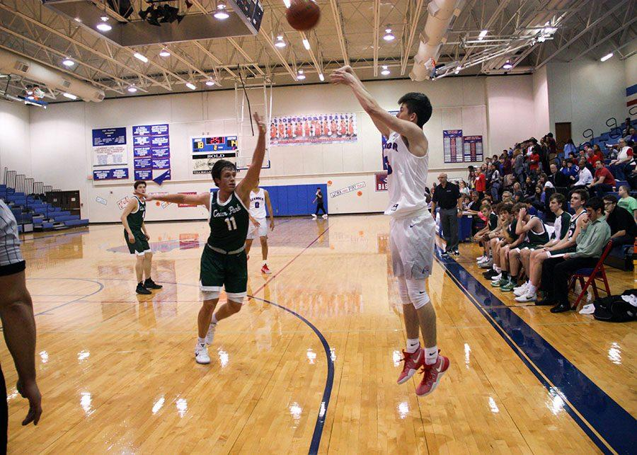 At a previous home game against Cedar Park, a Lion attempts to score. The Lions won this particular game 54-41.