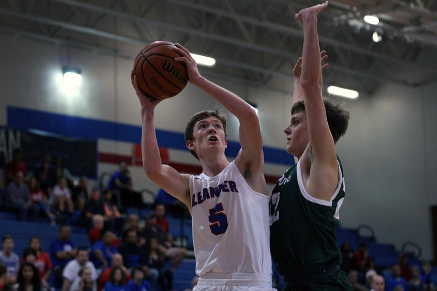 In a previous game, sophomore Hunter Stevens aims to score.  Stevens is one of two sophomores on the team.