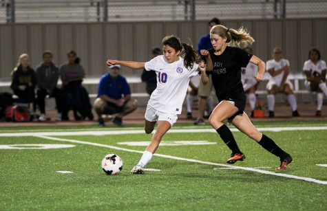 A JV player passes the ball during their game against Vandegrift.