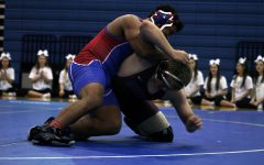 A wrestler competes during Leander's match during senior night.  They won this meet by a score of 67-6.
