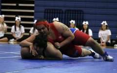 Senior Alex McGill wrestles during a meet against Austin High. He won this match.