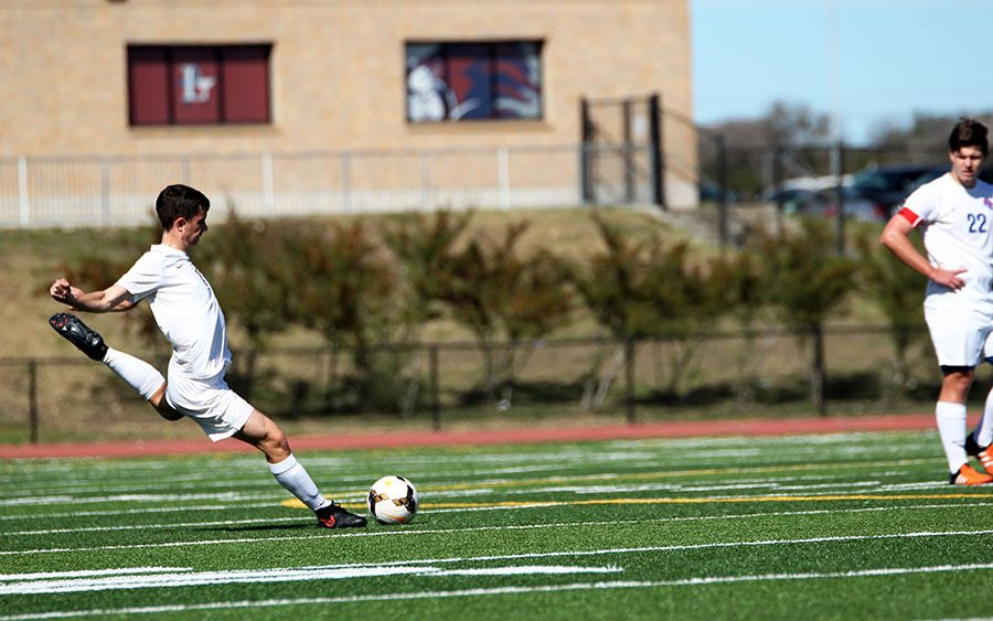 Junior Kyle Vogel takes a free kick against Marble Falls. This Friday will be their last game of the season.