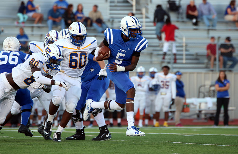 Junior Rashad Carter runs past the Pflugerville defense. He was replaced in the second half by sophomore Will Loofe.