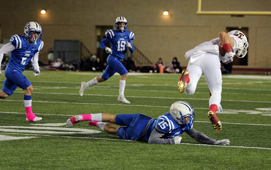 Senior Chase Barrick trips up a Lake Travis receiver. The Lions would fail to score in the game for the second consecutive game.