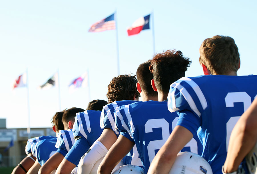 One of the biggest stories that had an effect on a vast amount of people was the debate over NFL players protesting the national anthem at their games. Here the varsity football players stand for the national anthem before their game against Pflugerville.