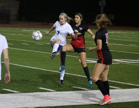 Junior Claire Imig attempting to get the ball away from Vista Ridge. The team ended up losing their next two games.