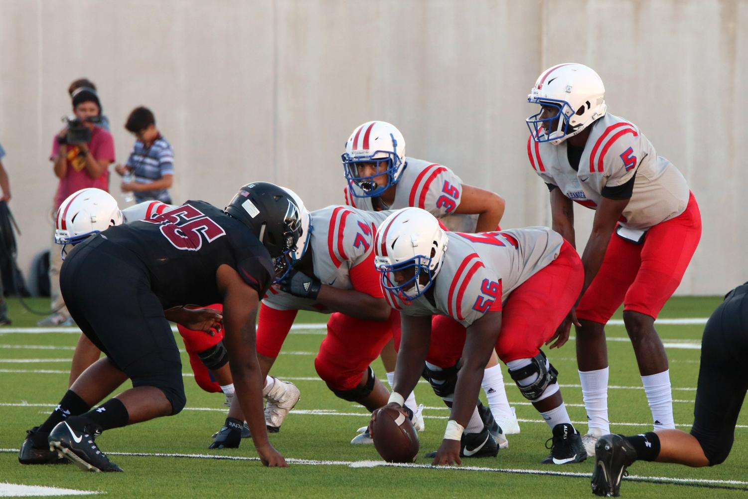 QB Rashad Carter (5) lined up behind center Eric Locust (56)