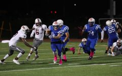 Adison Larue (34) jukes past defender for long run