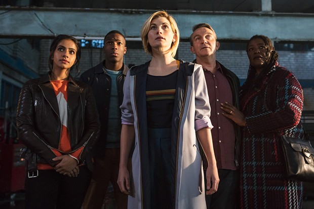 The Doctor (center) with her new companions
