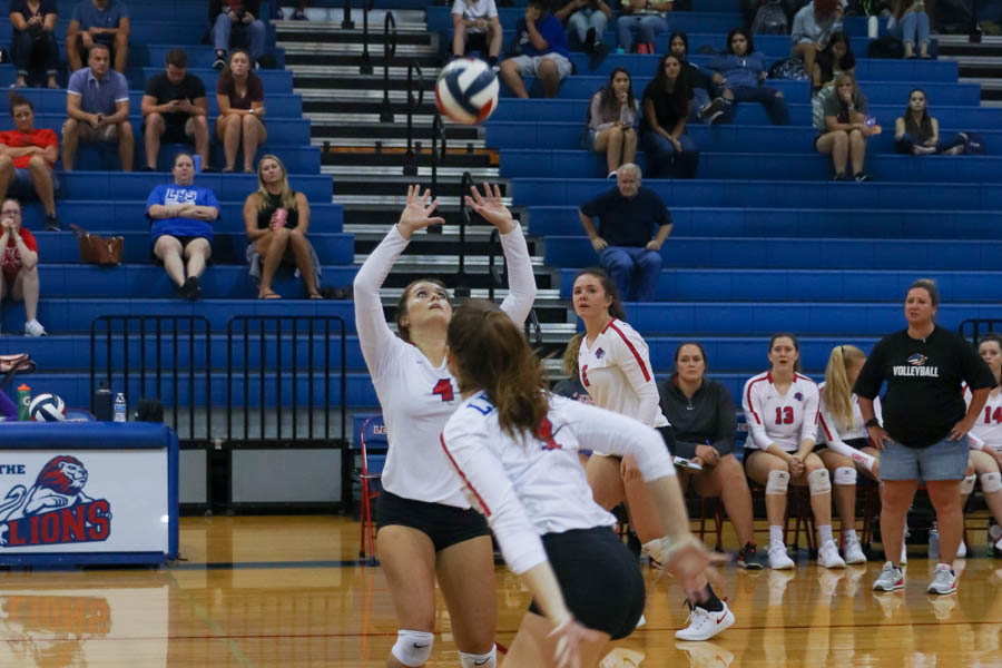 On Aug. 23, junior Callie Carrejo sets the volleyball to junior Presley Catalina. The lions won against Warren 2-0.
