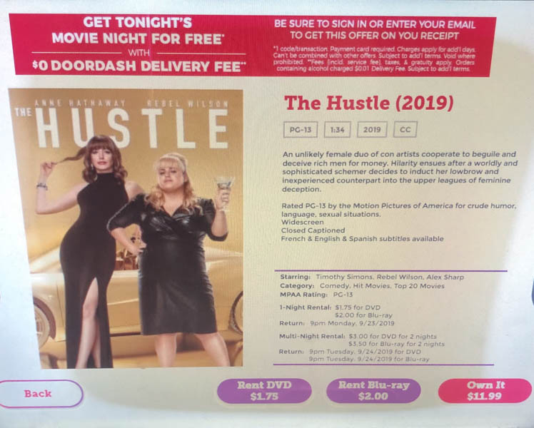 At+the+Redbox+located+in+front+of+walgreens%2C+the+movie+The+Hustle+is+available+for+rent.+