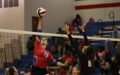 On Oct. 4, senior Juliann McGinnis makes a hit against a Vista Ridge blocker.