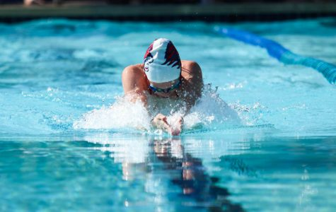 Senior Brelyn Cary competes in the 100 yard breaststroke. The swim team placed first overall at the Glenn/Gateway meet.