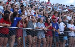 In the Bible stadium, the student section helps hype up the varsity football team during the scrimmage on Aug. 23.