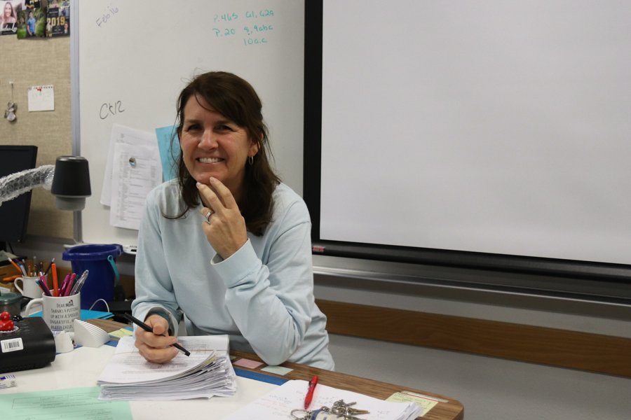 Math teacher Shawna Queen poses while grading papers on Jan. 30.